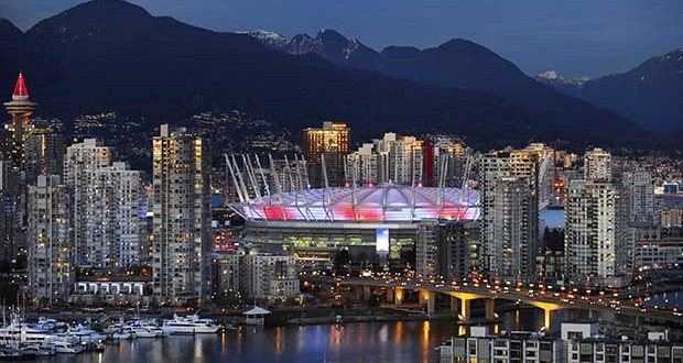 "Vancouver , BC.  December 21,  2011  Glowing in the evening light downtown Vancouver glows in the dusk  light, showing off  the newly renovated $550 million dollar,  B.C. PLACE stadium over false creek in Vancouver on December 21, 2011.        (Mark van Manen/PNG Staff  see Vancouver Sun /Province News stories ) 00057958A [PNG Merlin Archive] [Vancouver Sun eStore promotion Dec. 2011: ""TWILIGHT""] PROJECT=TOP 20 SUN PHOTOS"