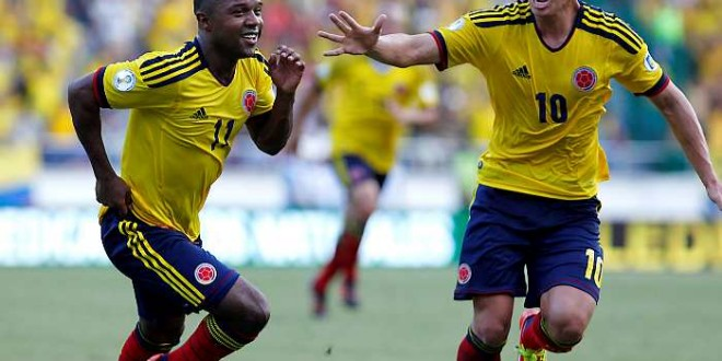 Colombia's Dorlan Pabon, left, celebrates with teammate James Rodriguez after scoring during a 2014 World Cup qualifying soccer game against Argentina, in Barranquilla, Colombia, Tuesday, Nov. 15, 2011. (AP Photo/Fernando Vergara)