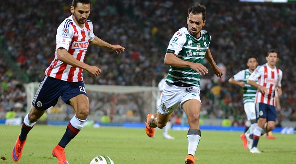 TORREON, MEXICO - MAY 21:  Raul Lopez of Chivas (L) and Adrian Aldrete of Santos (R) fight for the ball during a semifinal first leg match between Santos Laguna and Chivas as part of Clausura 2015 Liga MX at Corona Stadium on May 21, 2015 in Torreon, Mexico. (Photo by Oscar Wong/LatinContent/Getty Images)