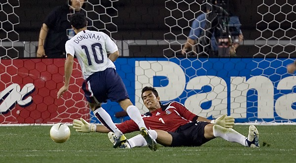 Landon Donovan avoids an outstretched Oswaldo Sanchez before scoring the clinching goal in the USA's 2-0 win.