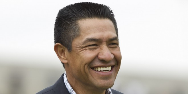 Chivas' new coach Ignacio Ambriz, smiles at the end of a soccer match against Pumas during a Mexican soccer league match in Mexico City, Sunday, Jan. 29, 2012. (AP Photo/Christian Palma)