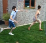 PIC FROM MERCURY PRESS (PICTURED: DANIEL HAMMOND, 26, ABOUT TO TACKLE HIS GIRLFRIEND ELEANOR MARTIN, 22) An unsuspecting girlfriend was left with her pants on display after her boyfriend hit her with a two-footed tackle that sent her flying into the air. This hilarious viral footage shows mum-of-one Eleanor Martin, 22, knocked over by 26-year-old partner Daniel Hammond as she prepared to take a shot. In the slapstick video carer Eleanor readies herself to kick the ball before Saturday footballer Daniel dives in to tackle her with both feet extended - leaving her in a heap on the ground with her dress blown into the air. The couples friend Oliver Wright, 26, filmed the footage in Daniels mum's back garden in Goole, Yorks, on Saturday (July 23) at about 9pm as the group enjoyed some drinks. SEE MERCURY COPY