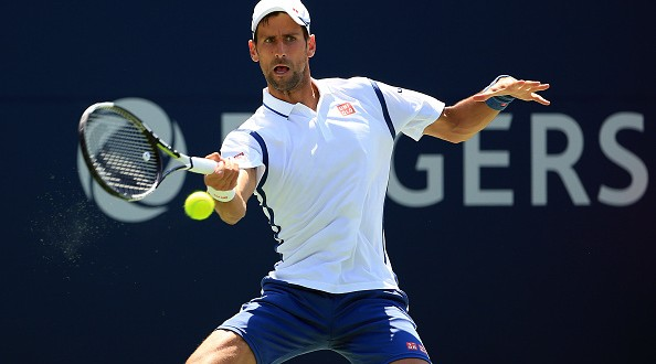 TORONTO, ON - JULY 27:  Novak Djokovic of Serbia plays a shot against Gilles Muller of Luxembourg on Day 3 of the Rogers Cup at the Aviva Centre on July 27, 2016 in Toronto, Ontario, Canada.  (Photo by Vaughn Ridley/Getty Images)
