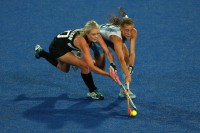 LONDON, ENGLAND - AUGUST 02: Samantha Harrison of new Zealand and Florencia Habif of Argentina compete for the ball in the Women's Hockey preliminary match between New Zealand and Argentina on Day 6 of the London 2012 Olympic Games at Riverbank Arena on August 2, 2012 in London, England.  (Photo by Daniel Berehulak/Getty Images)