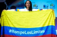 Colombian BMX cyclist Mariana Pajon, poses with the Colombian flag during a press conference on June 9, 2016, in Medellin, Antioquia department, Colombia. / AFP / -- / RAUL ARBOLEDA (Photo credit should read RAUL ARBOLEDA/AFP/Getty Images)