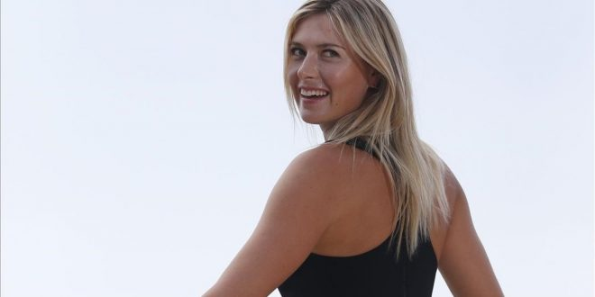 Russia s Maria Sharapova poses in Paris on June 8  2014 a day after winning the Roland Garros French Tennis Open    AFP PHOTO   KENZO TRIBOUILLARD