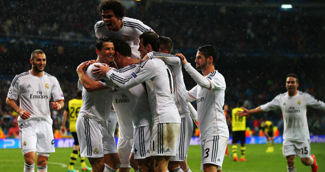 MADRID, SPAIN - APRIL 02: Cristiano Ronaldo of Real Madrid celebrates scoring his goal with team mates during the UEFA Champions League Quarter Final first leg match between Real Madrid and Borussia Dortmund at Estadio Santiago Bernabeu on April 2, 2014 in Madrid, Spain. (Photo by Clive Rose/Getty Images)