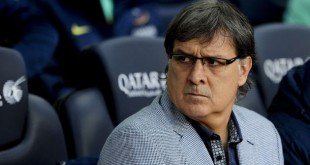 "Barcelona's Argentinian coach Gerardo ""Tata"" Martino looks on during the Spanish league football match FC Barcelona vs Granada CF at the Camp Nou stadium in Barcelona on November 23, 2013.   AFP PHOTO/ JOSEP LAGO"